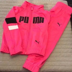 Puma track suit.